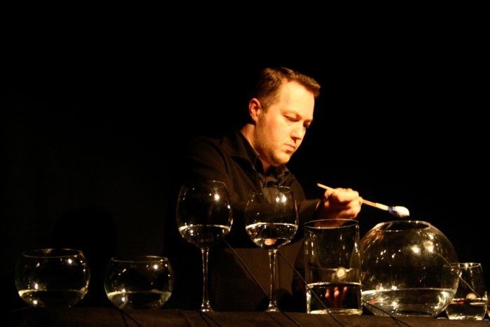 Lee Patterson adds a spoon of powder to a large glass of water
