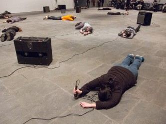 participants lies on the gallery floor face down and hit the floor with a mics