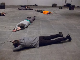 participants lies on the gallery floor face down and hit the floor with mics