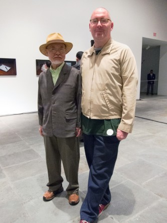 Tone and Meehan pose for a photo. Meehan in a beige jacket, Tone in a straw hat