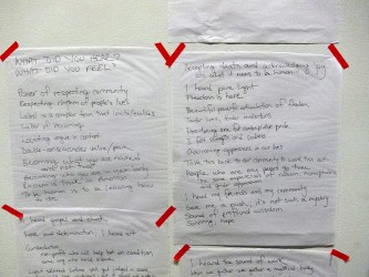 Two flipchart papers with answers to questions, what did you see,hear,feel