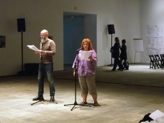 Dont Rhine and Nancy Nevarez stand by mics and read from scripts