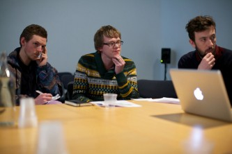 Three members of the discussion group listening
