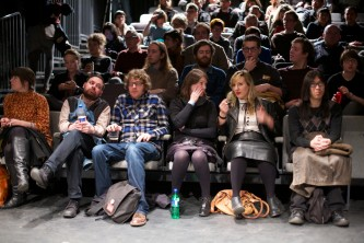 A wide shot of some of the audience listening to the talk