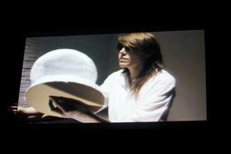 A shot of a screen showing Malin Arnell in sunglasses and a white outfit