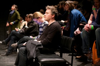 A side shot of a few rows of the audience during the discussion
