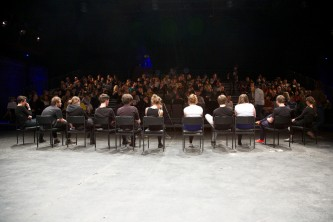 The cast face the audience during a question and answer session