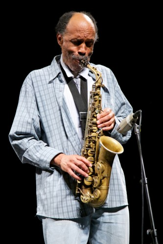 Daniel Carter plays a saxophone with intent