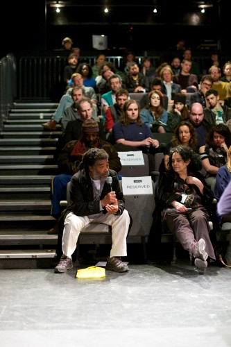 Wadada Leo Smith leans forward and asks a question during the discussion