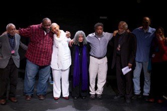 Some of the performers at Episode 4 give NourbeSe a hug after the performance