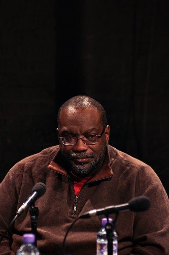Fred Moten sitting near water bottles during Episode 4