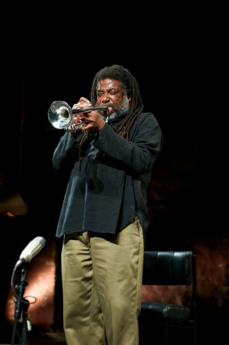 Wadada Leo Smith leans back and scrunches his eyes as he plays trumpet