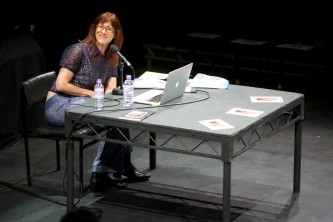 Ann Cvetkovich smiles as she turns to an audience member