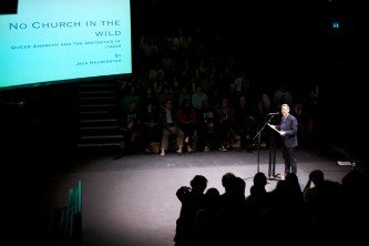 Jack Halberstam stands at a lecture with a screen in the foreground