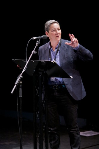 Jack Halberstam, in a suit, gesticulates whilst delivering a talk
