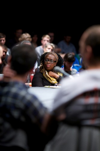 Charleen Sinclair listens in, in the foreground are two audience members