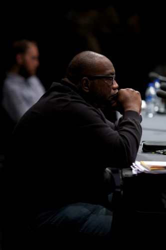 Fred Moten in profile hands on chin as he listens to the conversation