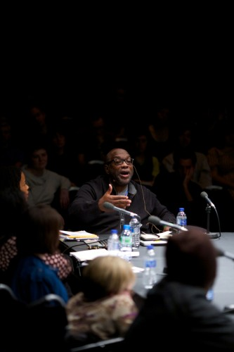 Fred Moten head back gesticulates as he addresses the group