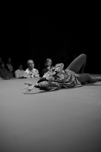 Miss Prissy lies prostrate on the floor during a solo dance
