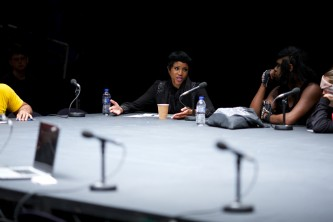 Ayana smiles as she participates in a round table discussion