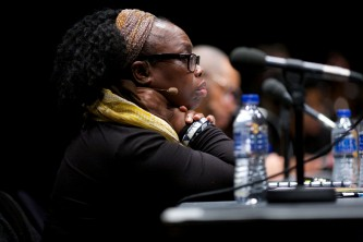 Charleen Sinclair in close and profile as she listens