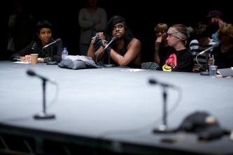 M Lamar looks to the ceiling as they talk to the group