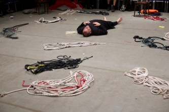 One member of Ueinzz lies on the floor with ropes all around