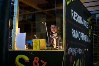 Laurence Rassel smiles whilst in a radio booth