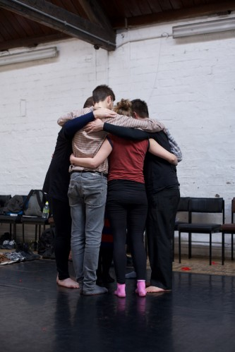 A group of participants gather in a group hug