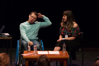 Robert Softley Gale and Maxine Meighan seated on stage at Tramway