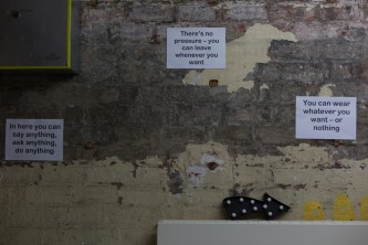 Signs on a wall giving details of a performance