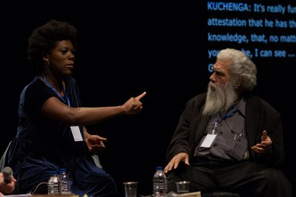KUCHENGA pointing at Samuel Delany by a small table