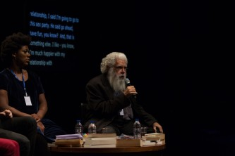 Samuel Delany speaks into a microphone during a discussion at EPISODE 9