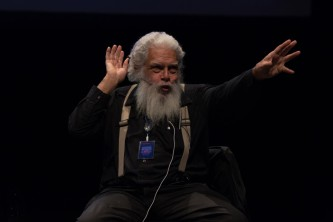 Samuel Delany gesturing with his hands during a talk at EPISODE 9