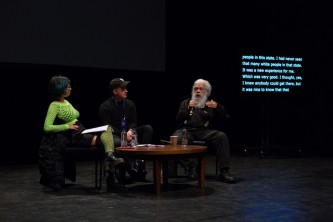 Jackie Wang, Huw Lemmey, Samuel Delany sitting around a table talking