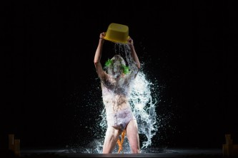 Basin of water poured over self in pastoral image of aquatic revelry