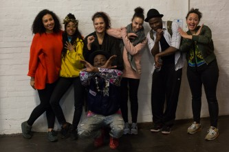 A group photos of dancers and organisers all pulling big grins