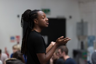 Someone speaks to a group of people attending a workshop