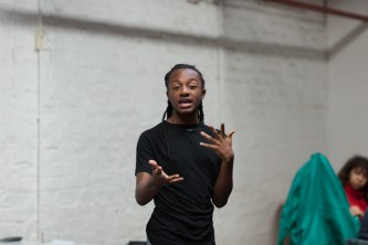 Someone stands and speaks to a group of people attending a workshop