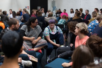 Groups of people have a discussion in a workshop