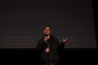 Eric Stanley stands and introduces the film criminal queers