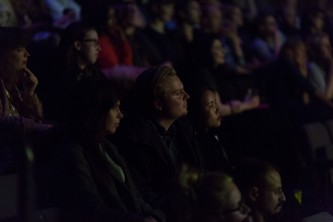 An audience watches the film Criminal Queers