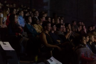 An audience member watches the performance of Resident Evil