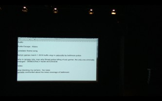 A projected screen, with text in a white box from a desktop.