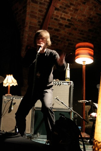 Richard Youngs stamps his foot and gesticulates as he sings energetically