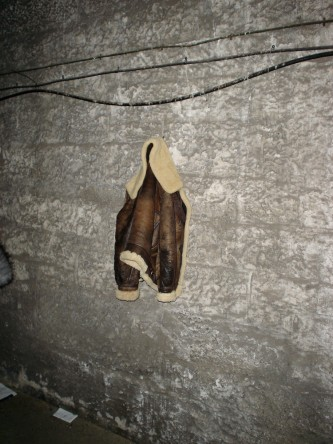 A jacket leather hanging on a wall inside Glasgow University bell tower