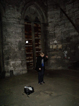 Aileen Campbell sings in a bell tower, facing the floor