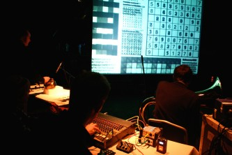 A screen showing a suduko page projected with players in front