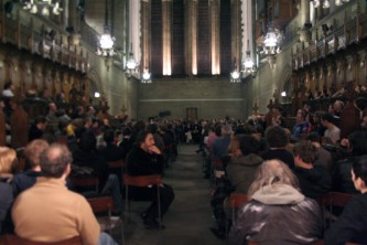 A large audience gathers in a church space