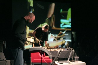 Nikos Veliotis and Rhodri Davies chip wood, cello and a projection in the back